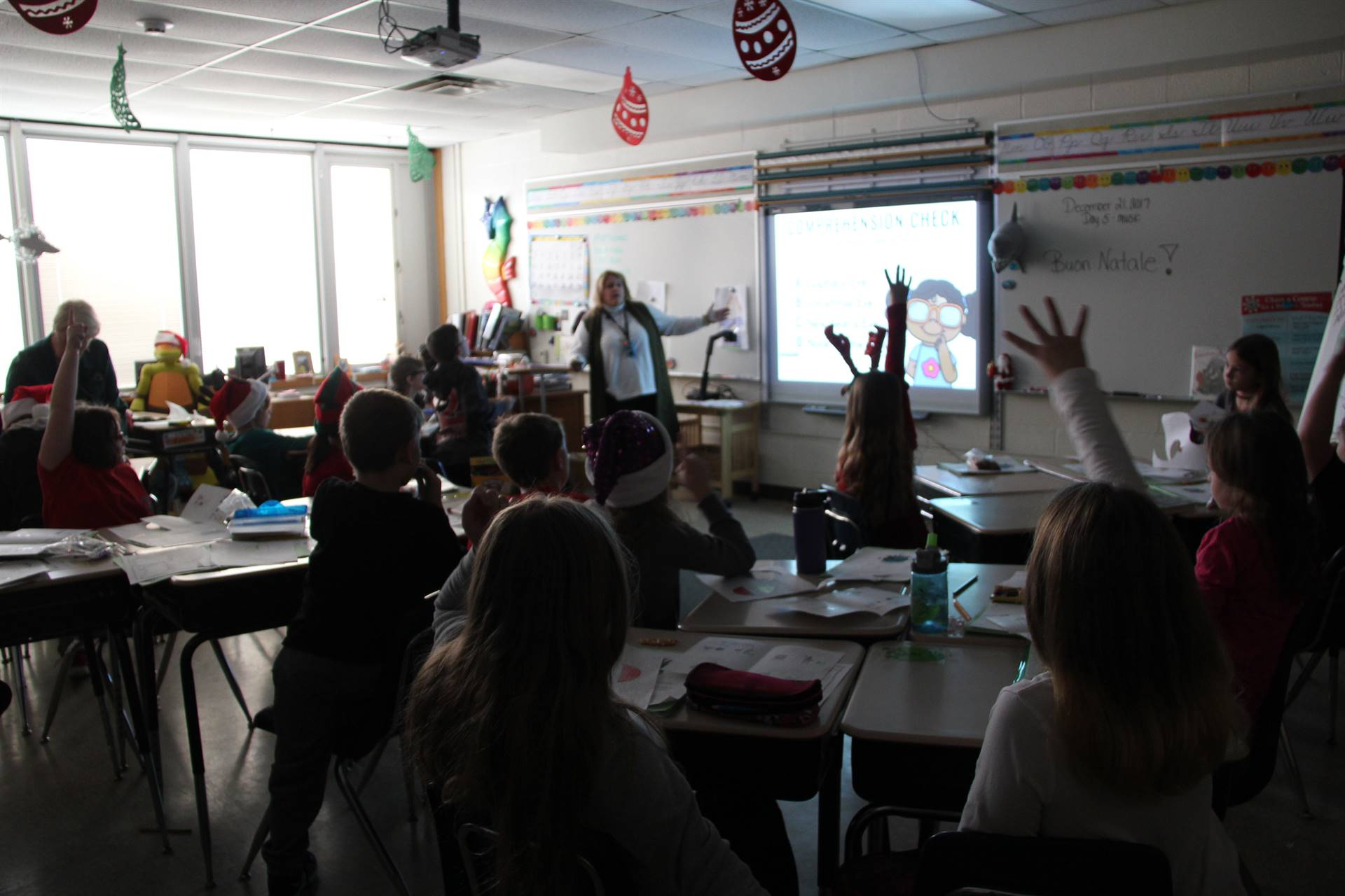 students raise hands to answer question