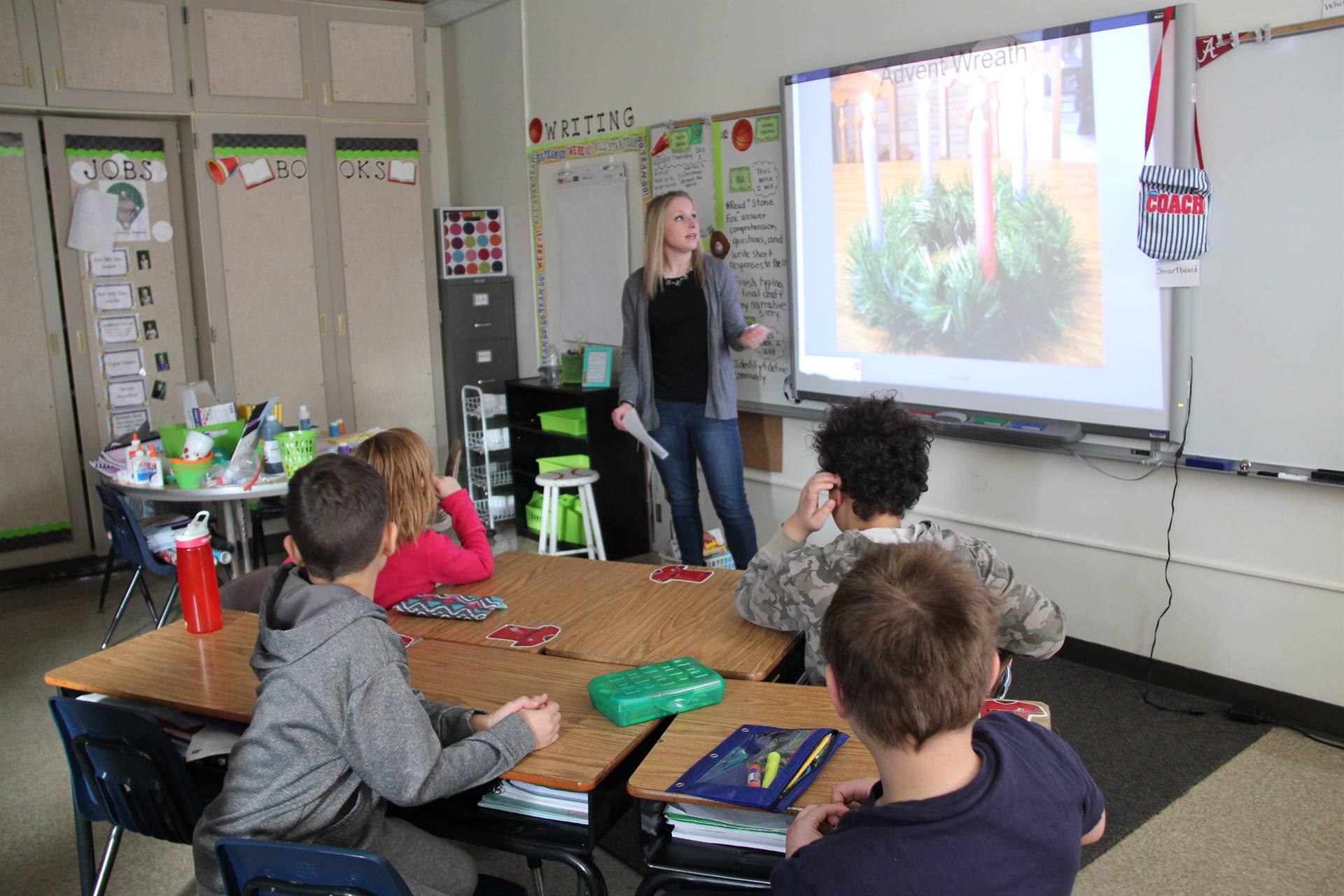 teacher showing powerpoint