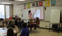teacher writing on smart board