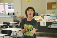 student juggling