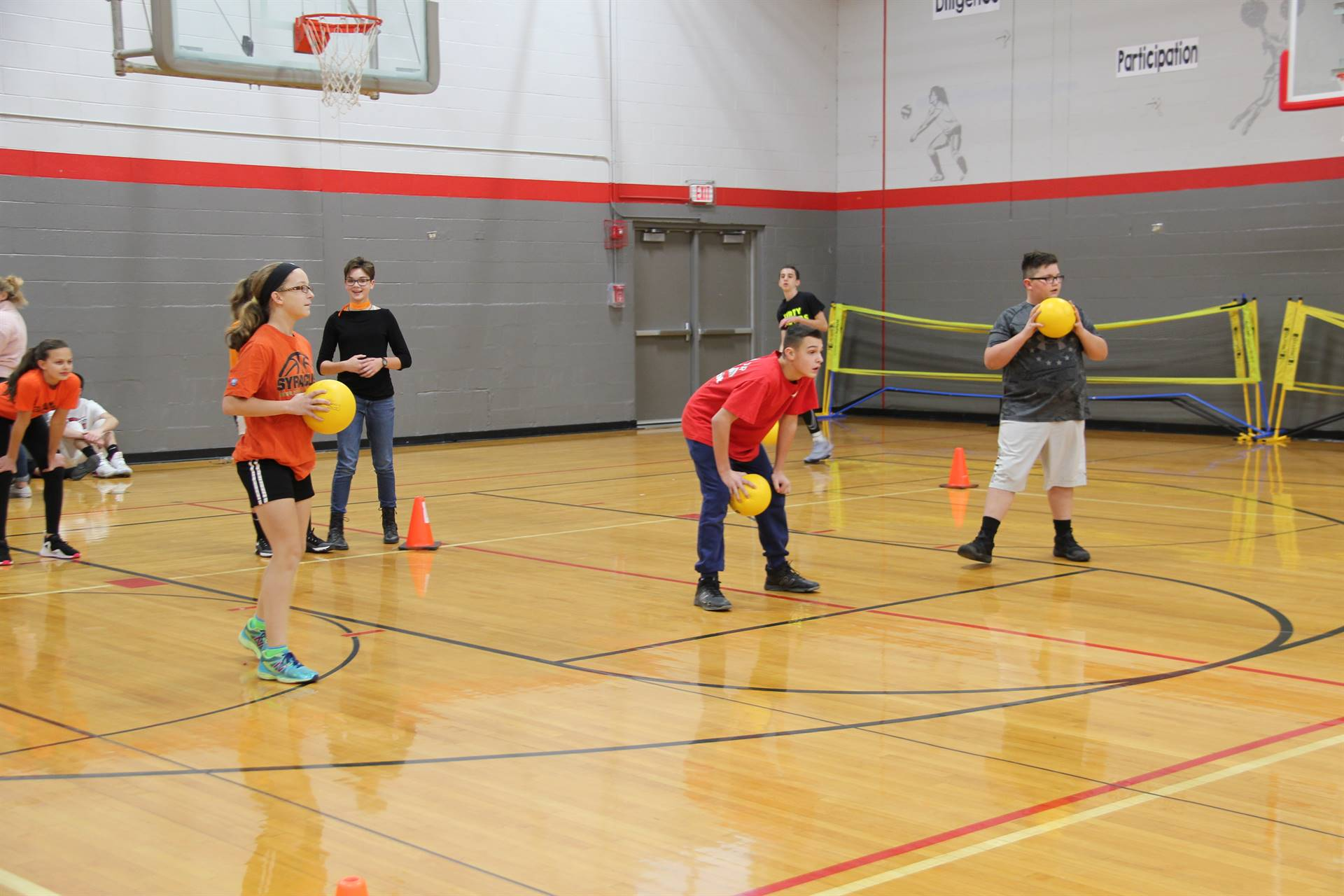 students playing dodgeball in gym