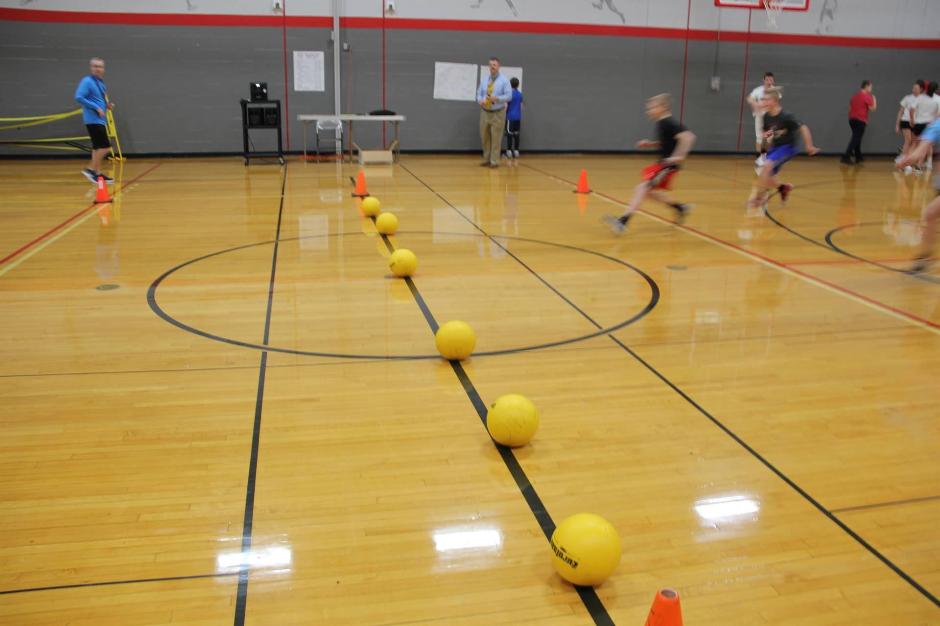 students running towards dodgeballs