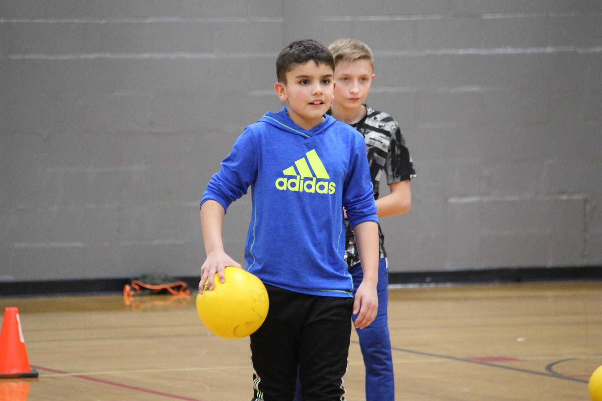 student holding dodgeball