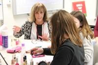 students paint nails