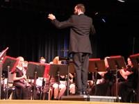 man conducting band