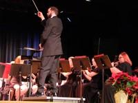 man conducting band at concert