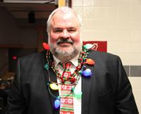 man wearing lightbulb necklace