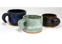 three mugs made from clay