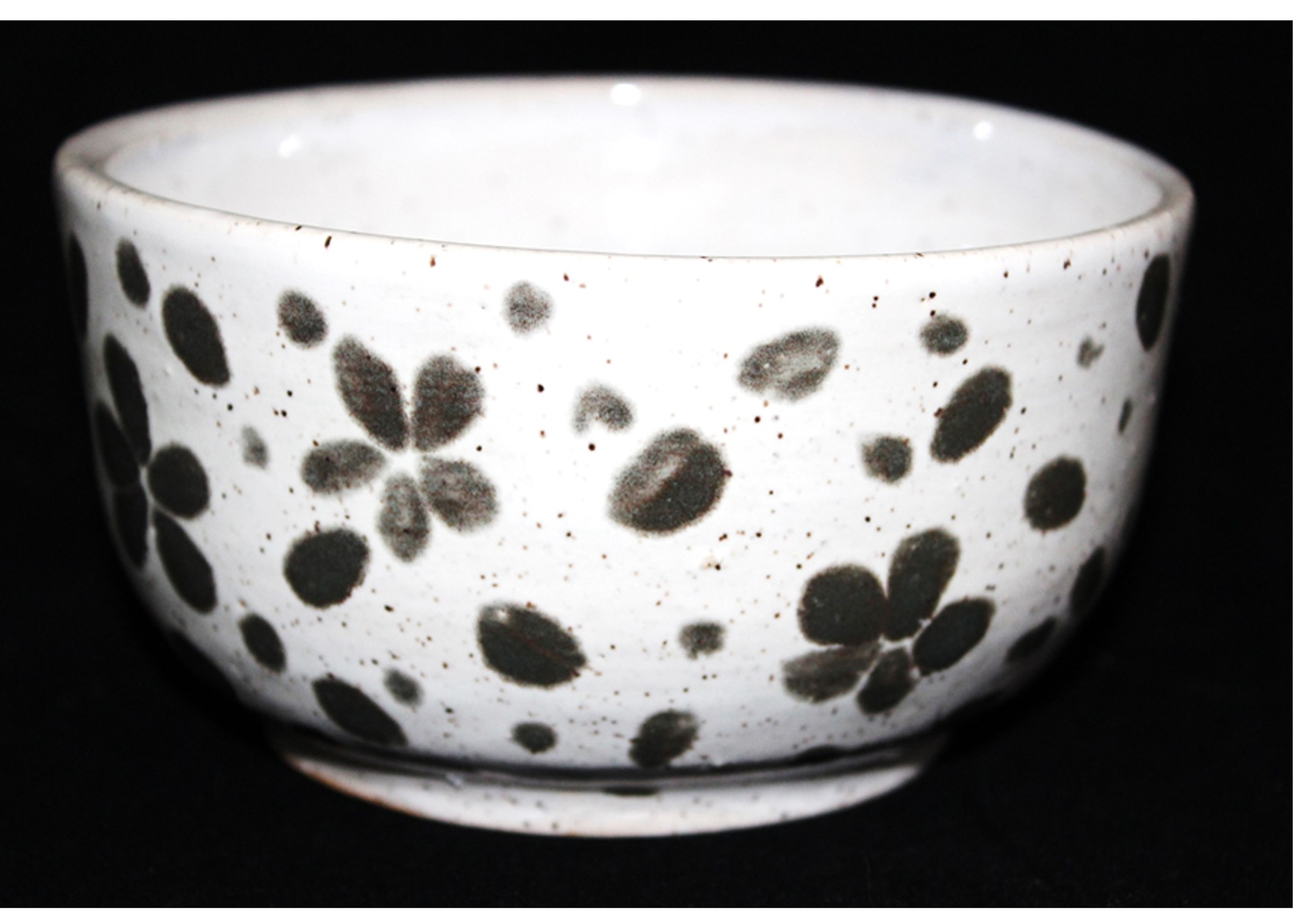 white bowl with dark green petals