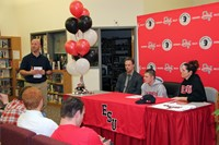 wide shot of student signing event