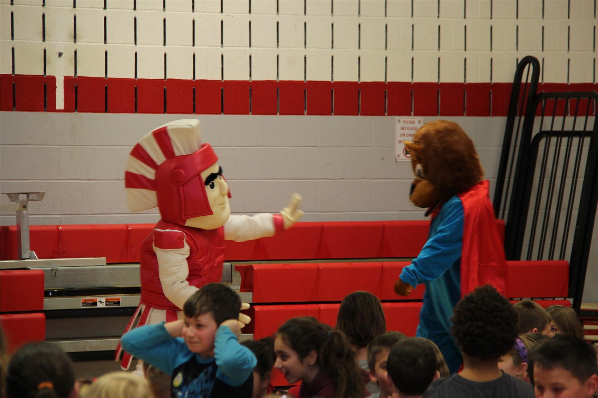 warrior mascot and bear mascot interact