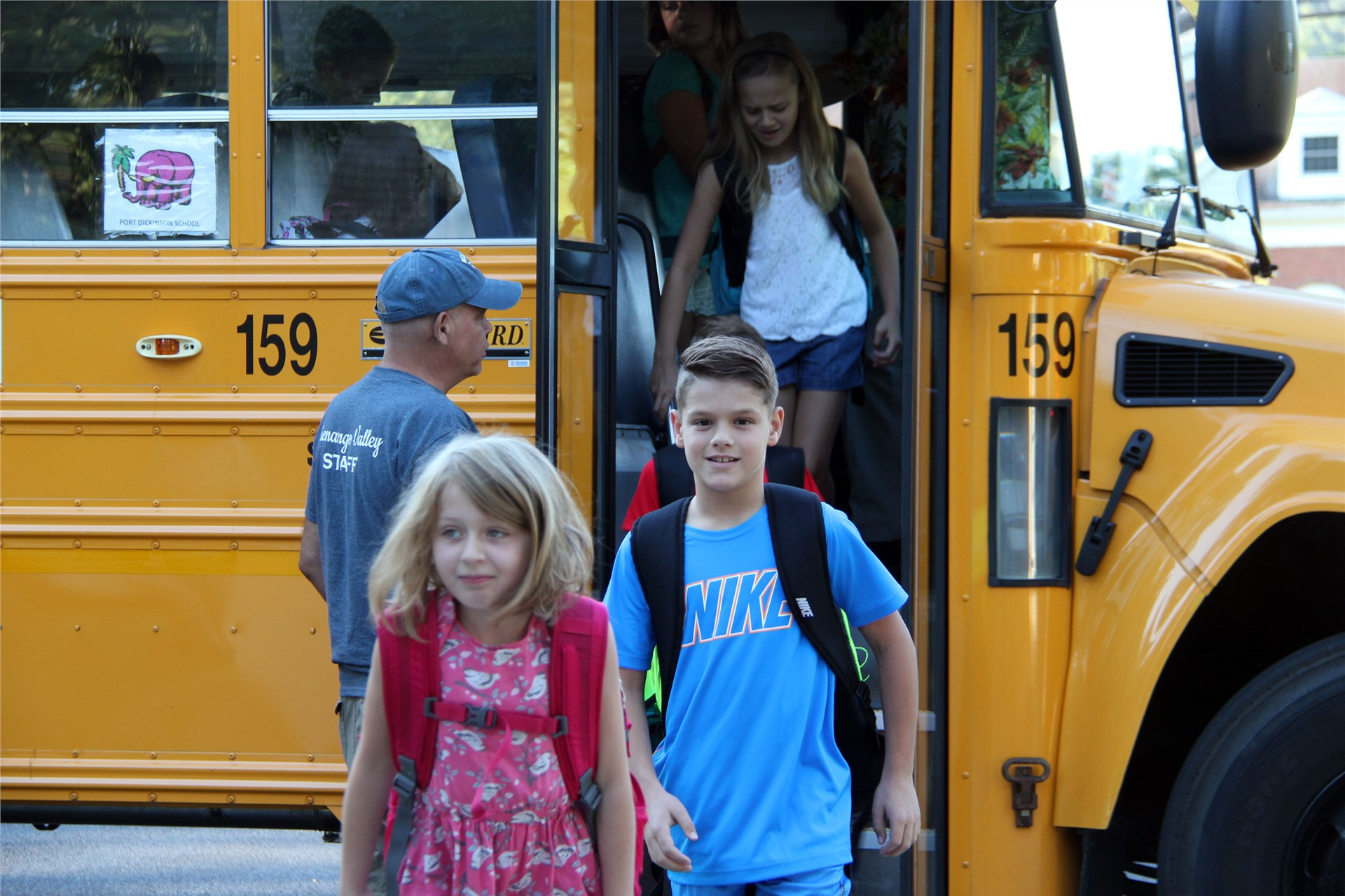 group of students exiting school bus