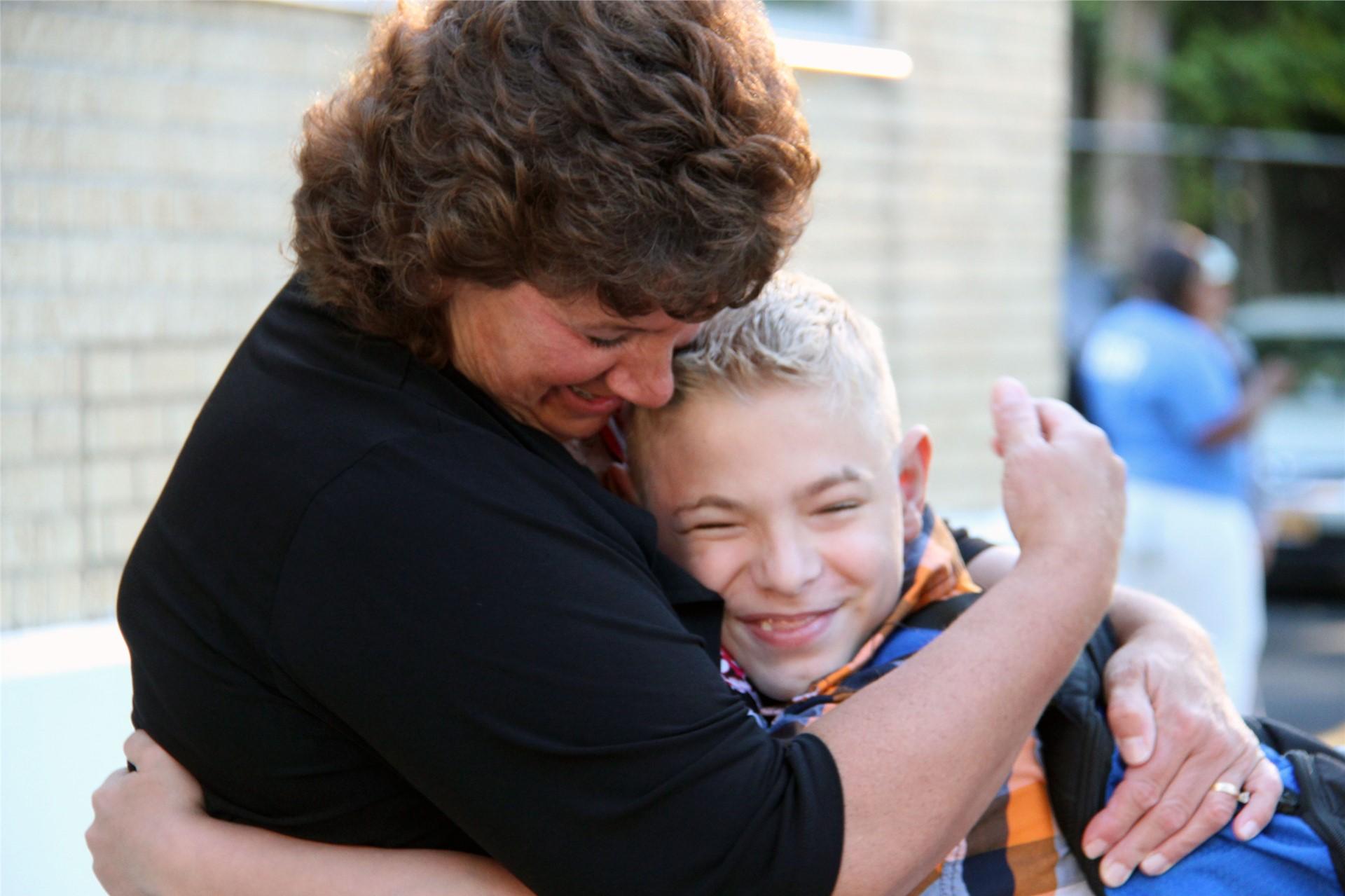 student hugging principal hammond