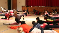 students learning yoga moves