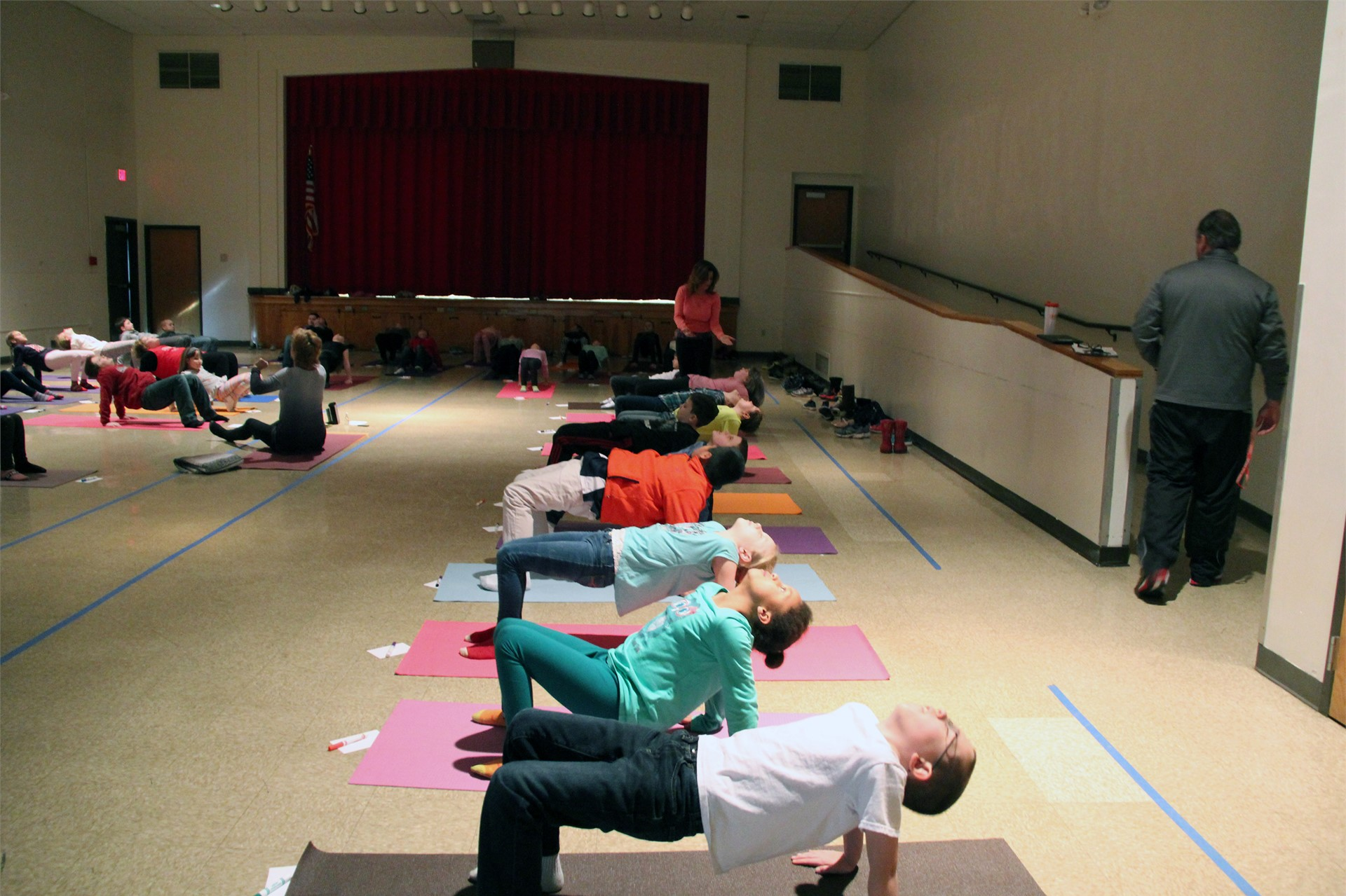 students doing yoga moves