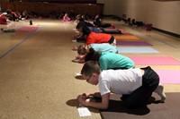 students doing yoga move