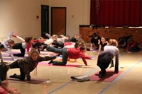 miss ann teaching students yoga