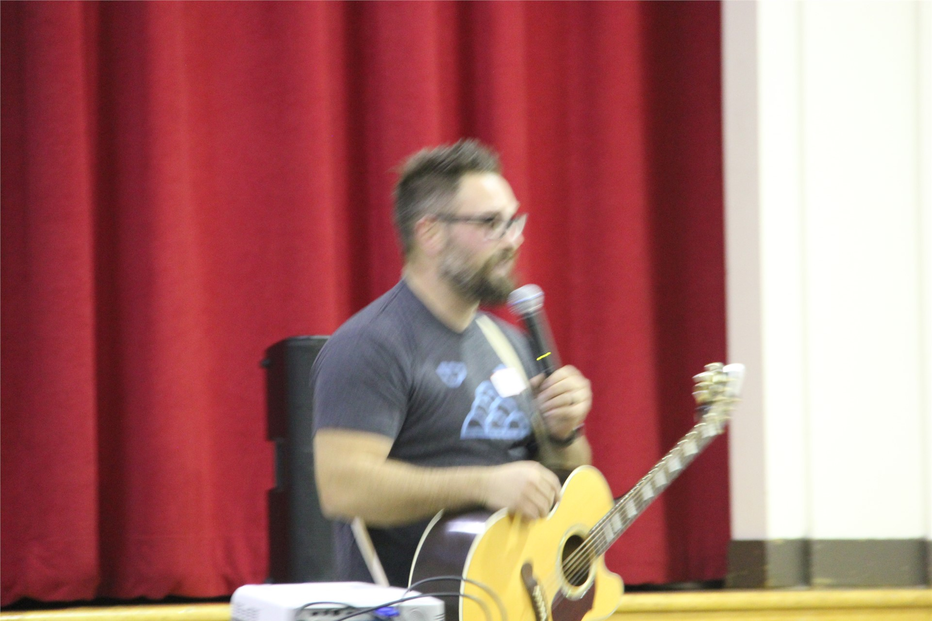closer shot of jared campbell singing