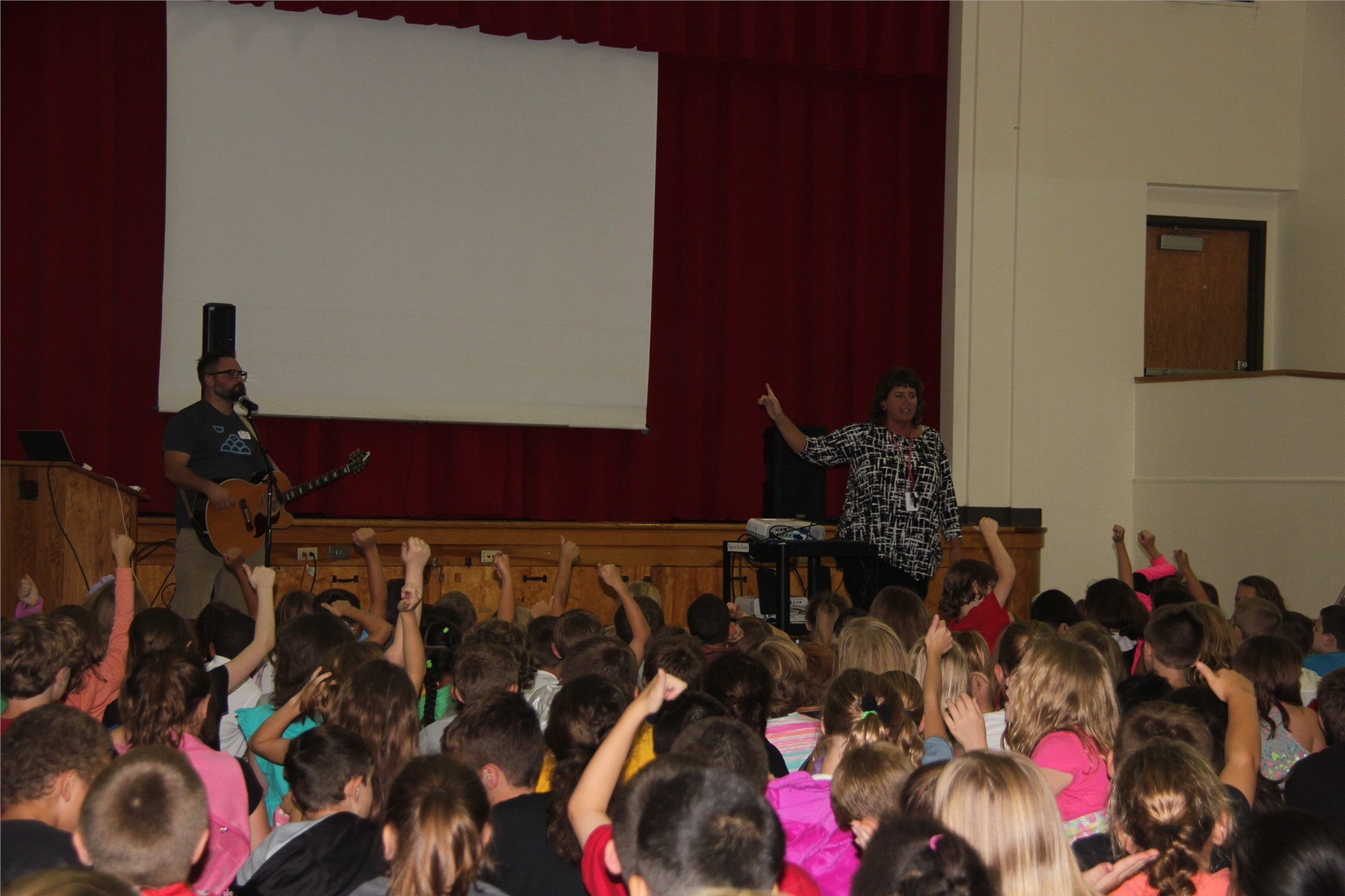 students raise hands to ask questions