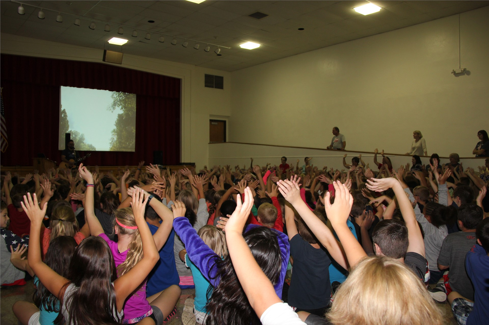 students put hands in air listening to music