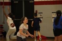 students throwing footballs