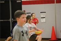 students catching footballs