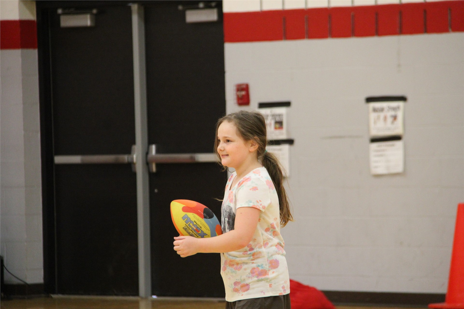 student about to throw football