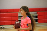 student holding football
