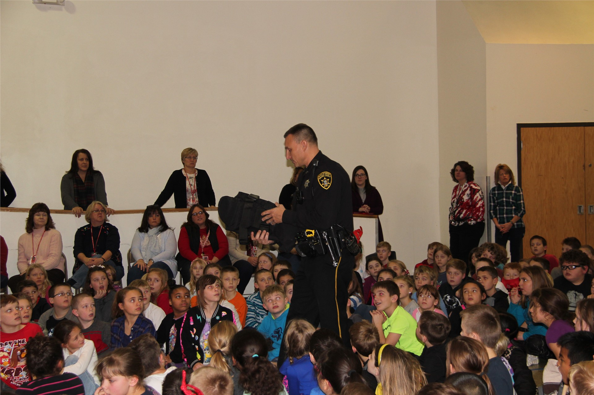 Officer showing students equipment