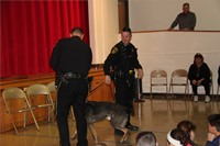 two officers standing with police dog