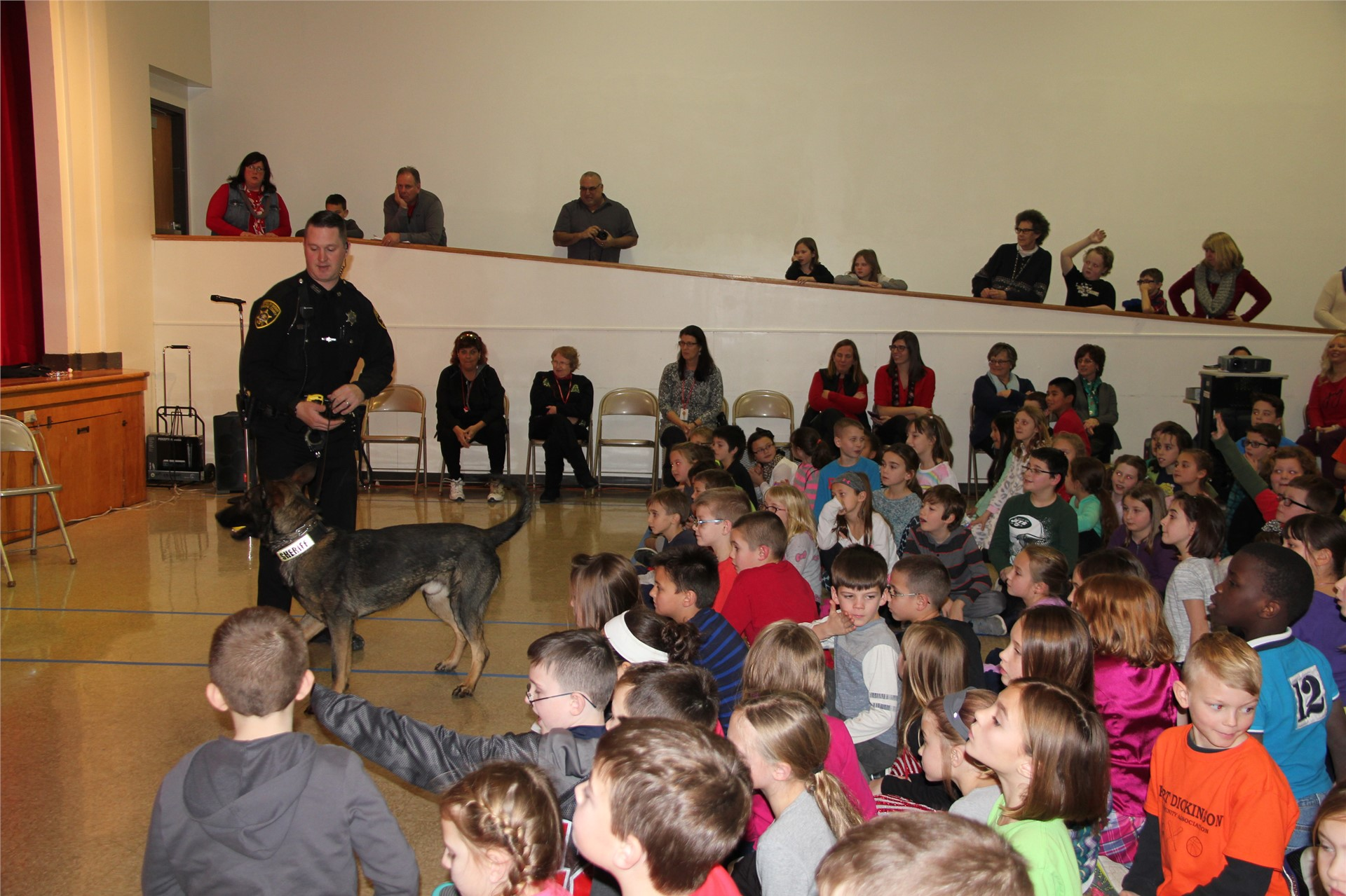 students watching officer and police dog