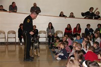 officer and police dog standing in front of students