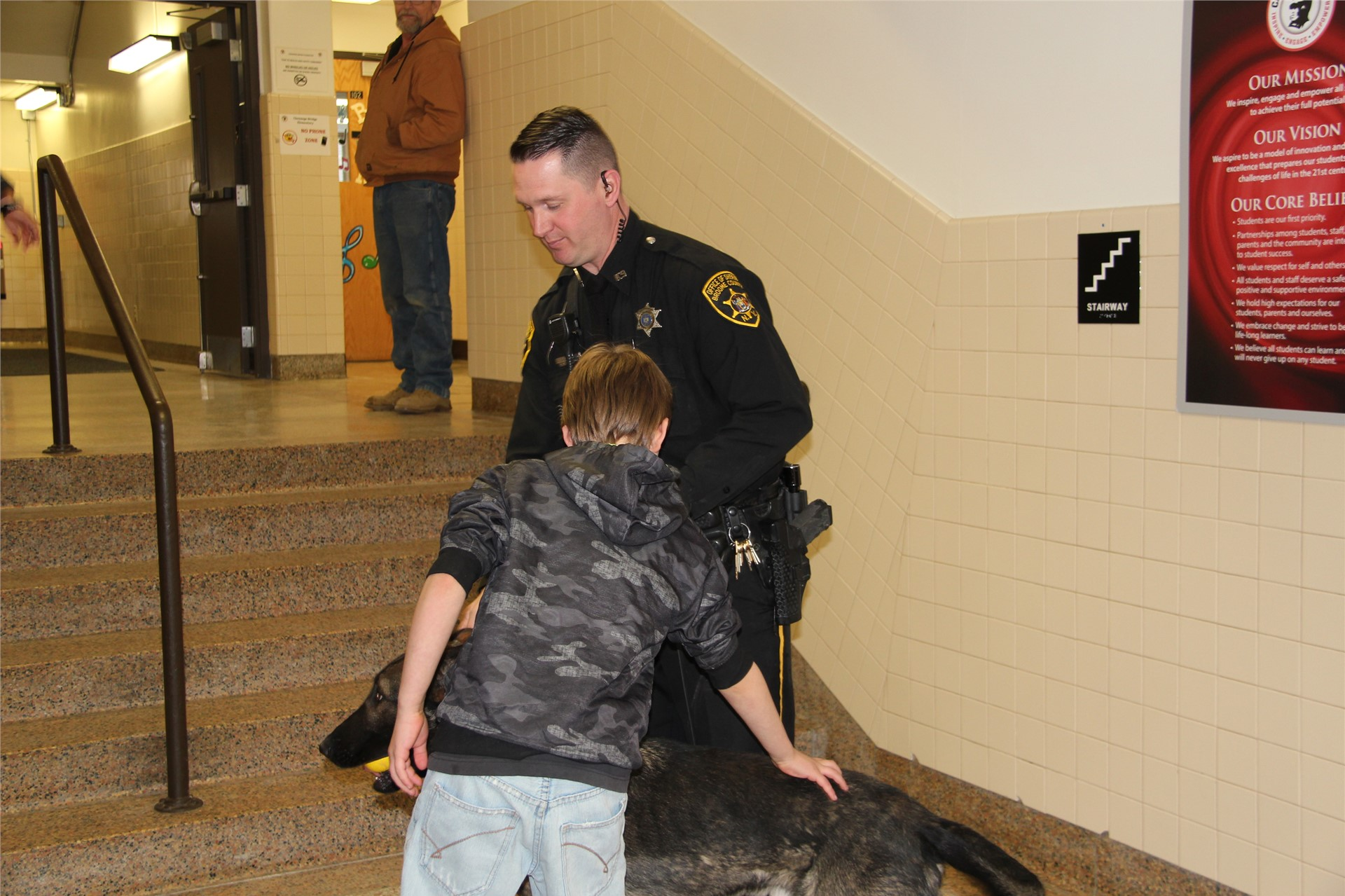 another student petting police dog