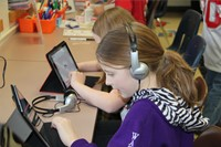 students listening to i pads
