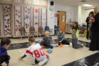 students working with electronic devices in steam room