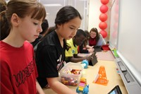 students working on projects at table