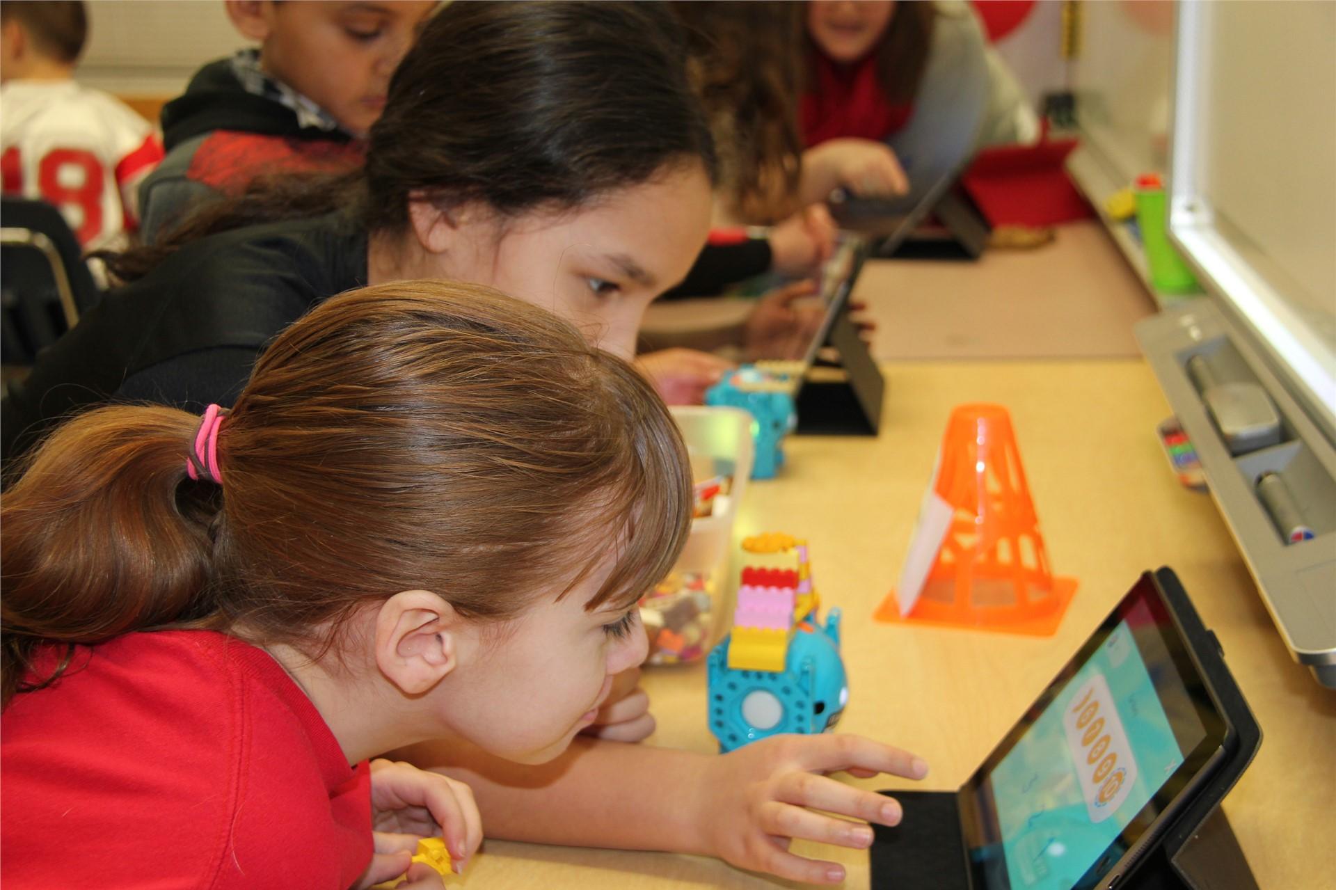 two students looking at i pad