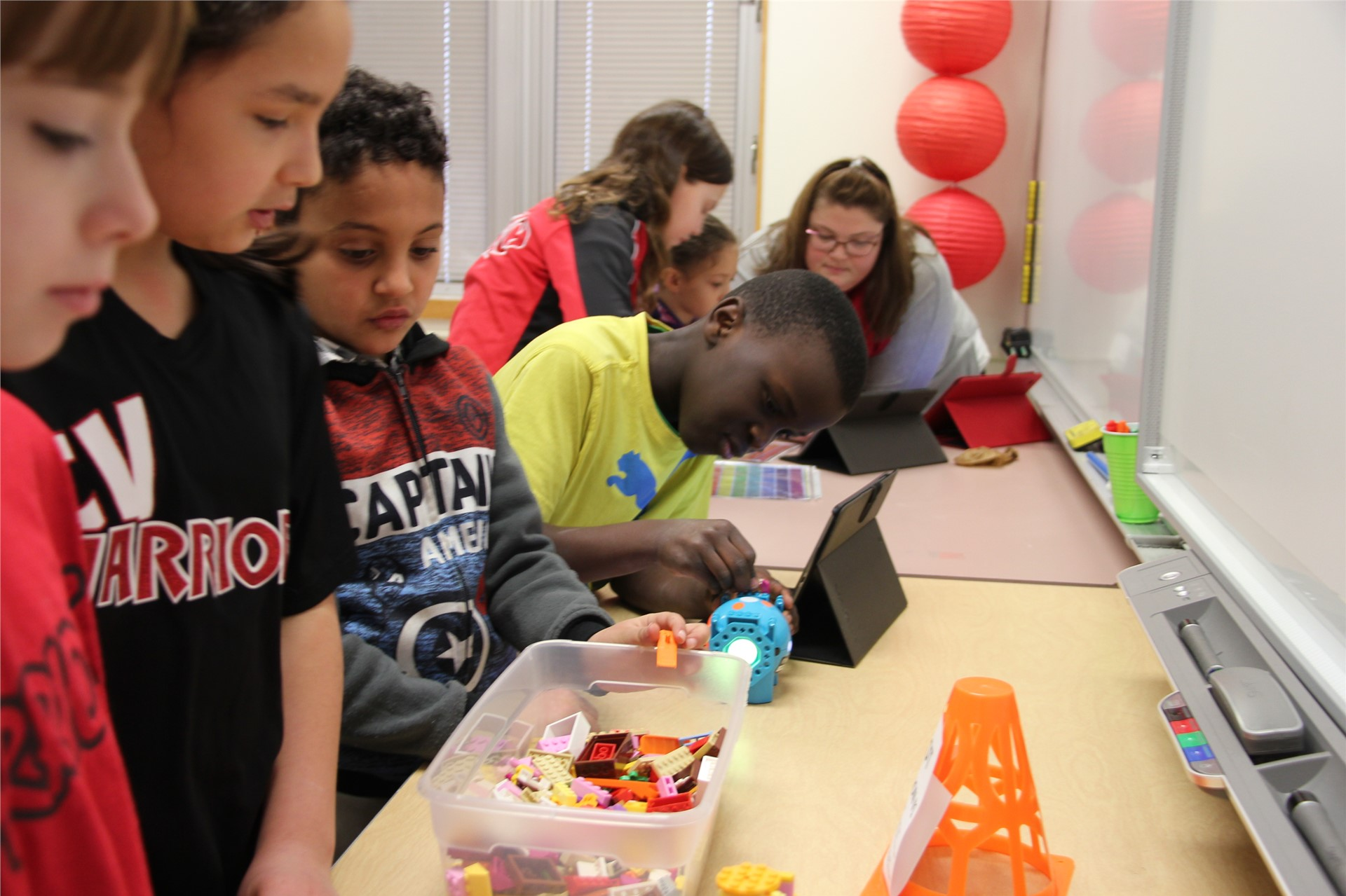 students work on projects at table