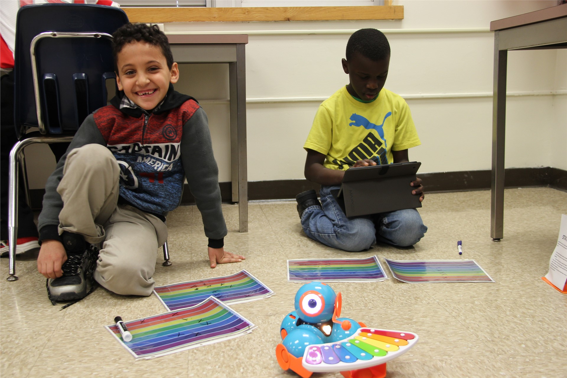 students play with electronic devices