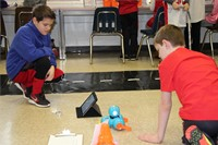 two students testing electronic device
