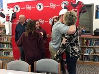 student hugs woman