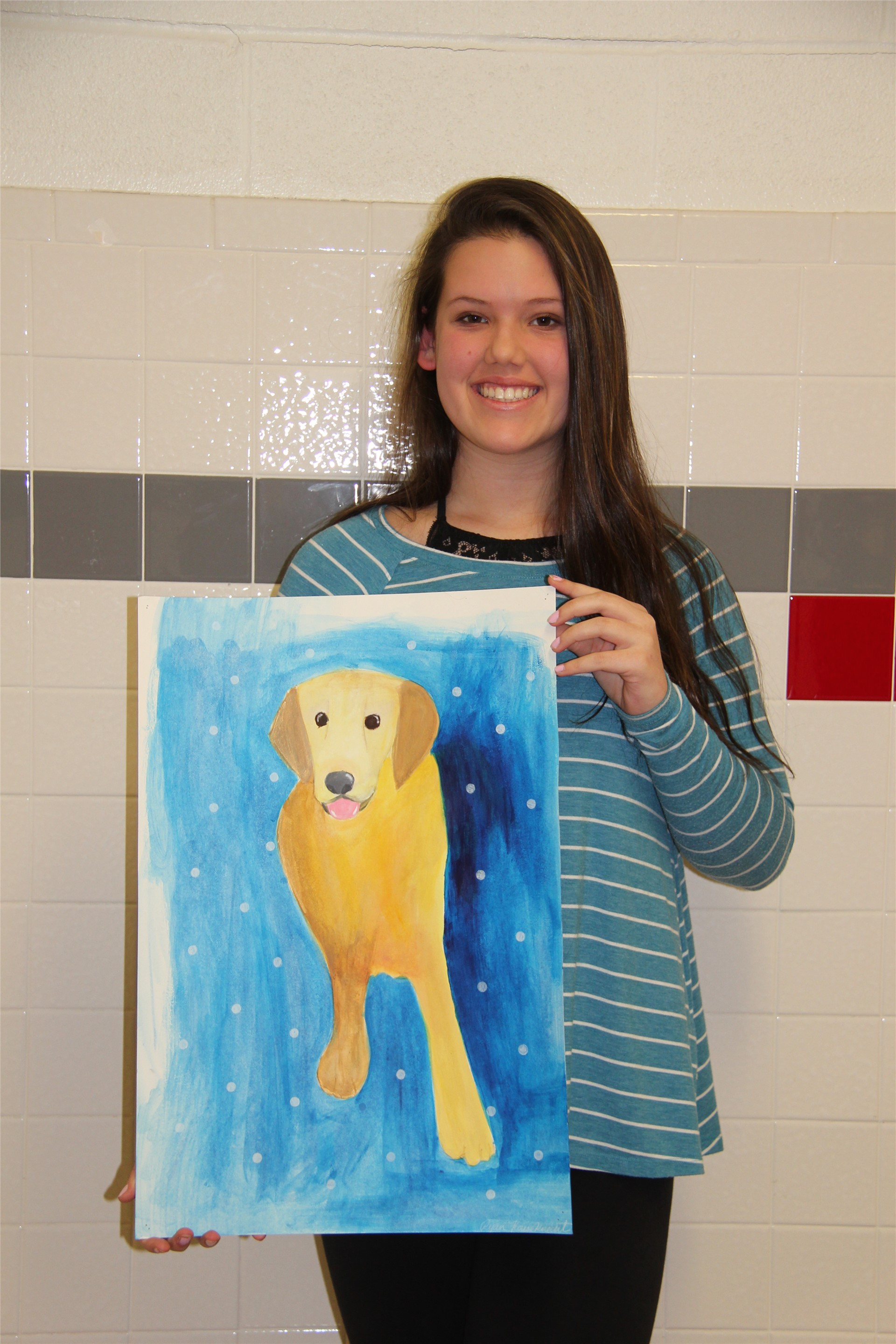 another student holding painting of dog