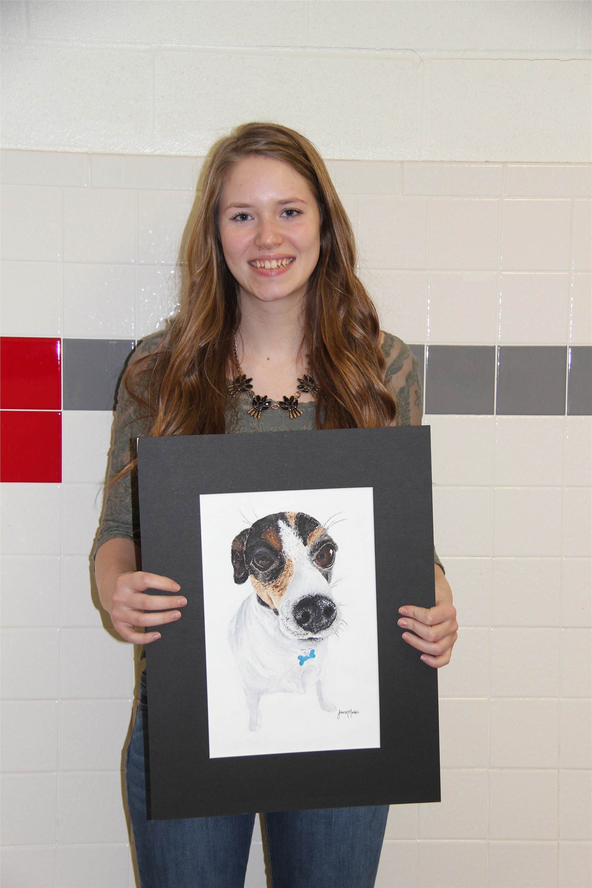 student holding illustration of dog