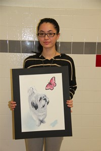 another student holding illustration of dog