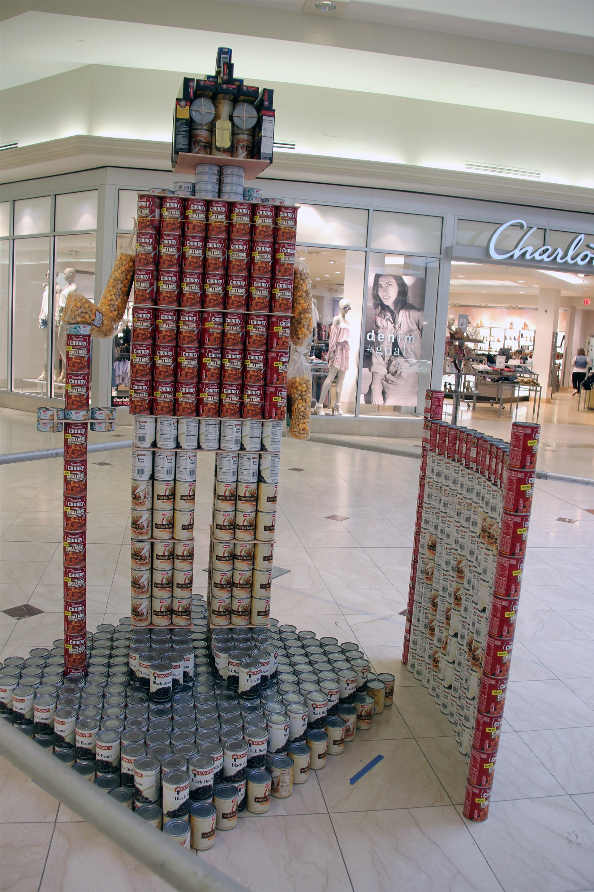 full shot of structure made of cans