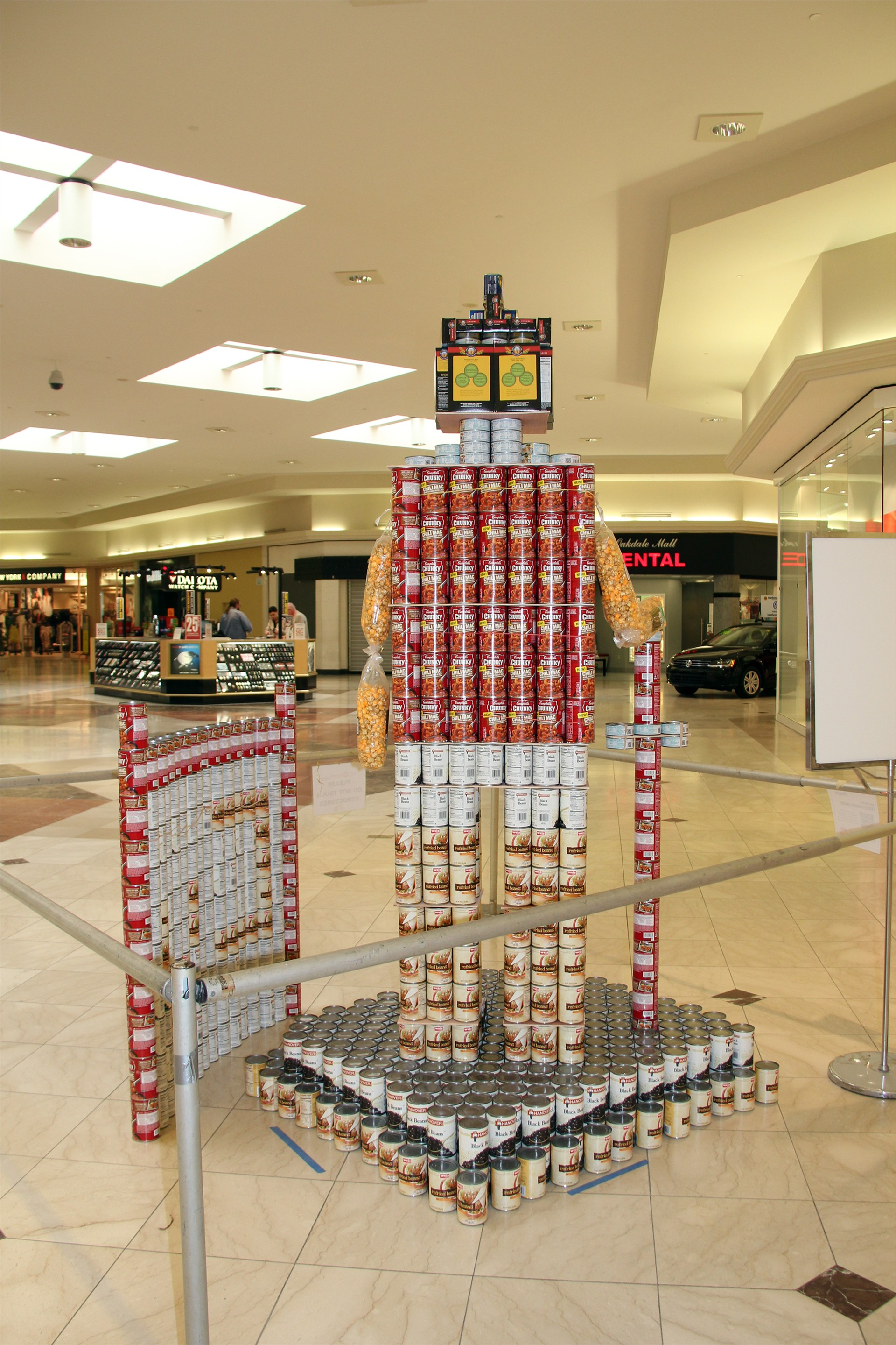 wide shot of structure made of cans