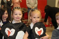 students smiling in penguin costumes