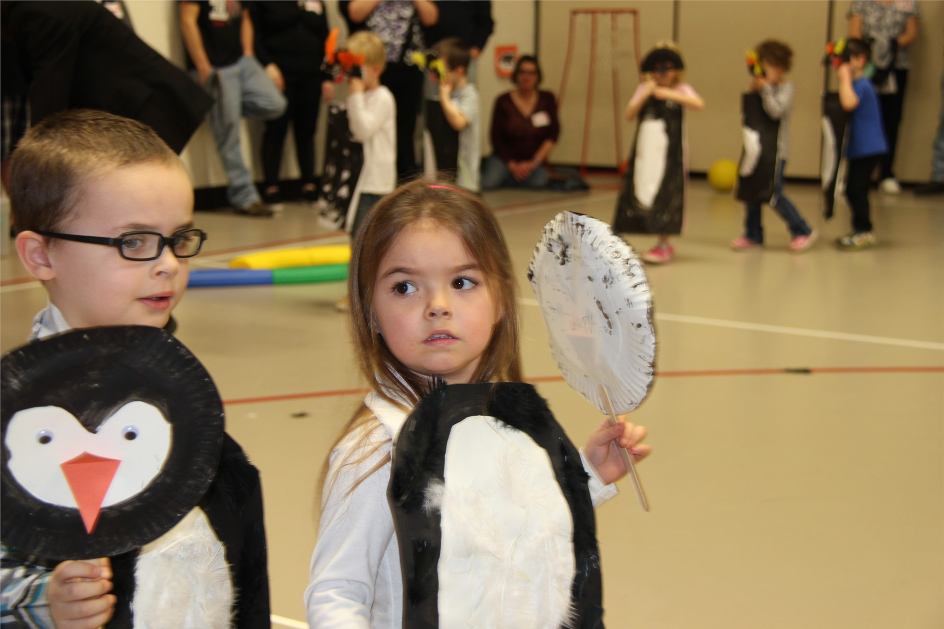 two students with penguin costumes