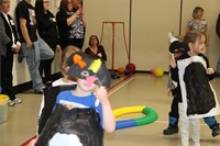 students dressed up in penguin costumes
