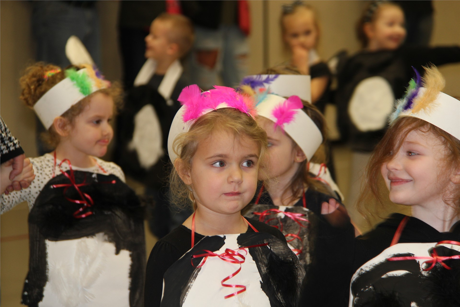 group of students dressed in penguin costumes